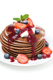 Pancakes with cream and fresh berries, close-up, isolated Stock Photography