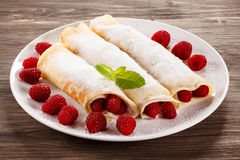 Pancakes with cream and raspberries stock photography