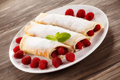 Pancakes with cream and raspberries royalty free stock images