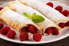 Pancakes with cream and raspberries stock photos