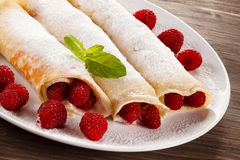 Pancakes with cream and raspberries Royalty Free Stock Image