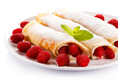 Pancakes with cream and raspberries Royalty Free Stock Photography