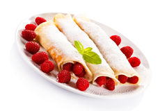 Pancakes with cream and raspberries Stock Image