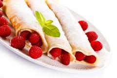 Pancakes with cream and raspberries stock image