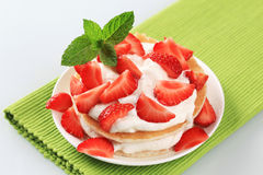Pancakes with cream and strawberries Royalty Free Stock Image