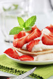 Pancakes with cream and strawberries Royalty Free Stock Photo