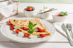 Pancakes with cream and strawberries Royalty Free Stock Photos