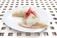 Pancakes cream and watermelon on white plate dessert Royalty Free Stock Photography