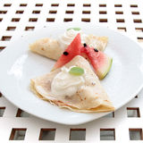 Pancakes cream and watermelon on white plate dessert Stock Image