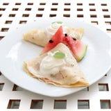 Pancakes cream and watermelon on white plate dessert Stock Image