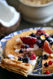 Pancakes with creamy sauce, berries and nuts stock image