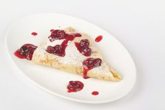 Pancake with cherry. Pancakes crepes with cherry - healthy breakfas Royalty Free Stock Photography