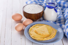 Pancakes or crepes and ingredients Royalty Free Stock Photo