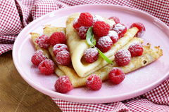Pancakes (crepes) with raspberries and mint Royalty Free Stock Photos