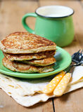 Pancakes and cup of milk Royalty Free Stock Photography