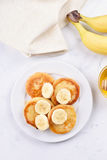 Pancakes with curd and banana slices Stock Image