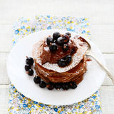 Pancakes with currants and chocolate Royalty Free Stock Photo