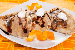 Pancakes decorated with orange Stock Images