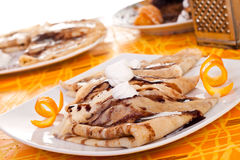 Pancakes decorated with orange peel Royalty Free Stock Photos