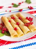 Pancakes decorated with red currant berries. Royalty Free Stock Images