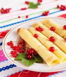 Pancakes decorated with red currant berries. Stock Photo