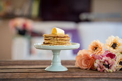 Pancakes. Delicious pancakes with butter on a wooden table Stock Photo