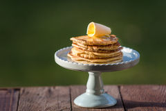 Pancakes. Delicious pancakes with butter on a wooden table Royalty Free Stock Photography