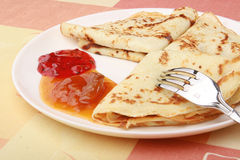 Pancakes with delicious jam on white plate. Delicious pancakes with delicious jam on white plate Royalty Free Stock Photo