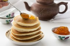 Pancakes with delicious jam on white plate. Deliciouos pancakes with delicious jam on white plate Stock Images