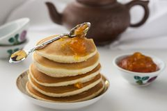 Pancakes with delicious jam on white plate. Deliciouos pancakes with delicious jam on white plate Stock Image