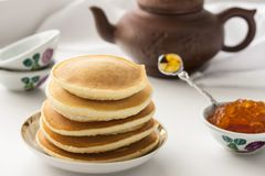 Pancakes with delicious jam on white plate. Deliciouos pancakes with delicious jam on white plate Stock Photography