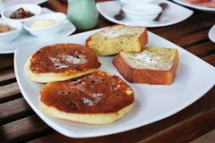 Pancakes in a dish placed on a table. stock photography