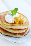 Pancakes with dried fruit Stock Photos