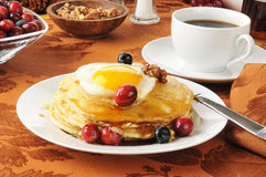 Pancakes with an egg on top Stock Photos