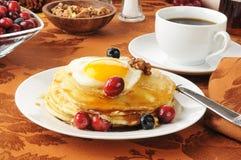 Pancakes with an egg on top Stock Photos