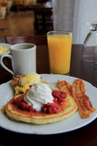 Pancakes and eggs benedict Royalty Free Stock Photos