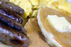 Pancakes, Eggs and Sausage 3. A good start to the day with Pancakes, eggs and sausage Stock Images