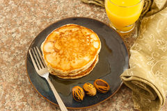 Pancakes favored with nutmegs Royalty Free Stock Photography