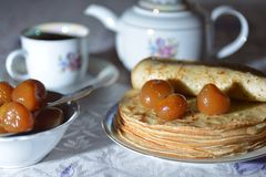 Pancakes with a fig jam and tea Stock Images