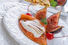 pancakes with figs and cherries Stock Image