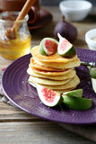 Pancakes with figs and honey Stock Image