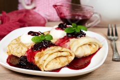 Pancakes filled with cottage cheese and blackcurrant jam. Maslenitsa. Pancakes filled with cottage cheese and blackcurrant jam. Traditional Russian cuisine royalty free stock photos