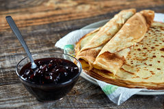 Pancakes filled with dark cherry jam Stock Photo