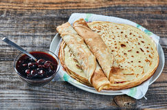 Pancakes filled with dark cherry jam Royalty Free Stock Image