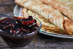 Pancakes filled with dark cherry jam Stock Photos