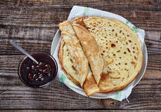 Pancakes filled with dark cherry jam Royalty Free Stock Images