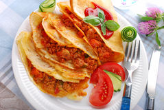 Pancakes filled with minced meat and vegetables Stock Photos
