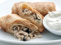 Pancakes filled with minced mushrooms Royalty Free Stock Photos