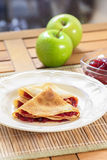 Pancakes filled with strawberry jam Stock Photo