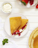 Pancakes filled with whipped cream Royalty Free Stock Photo